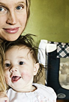 Dana Albillo, a midwife, holds her daughter Perla, whom she delivered at home.