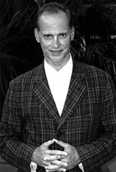If that ain't a come-hither smile on John Waters' face,      what is?