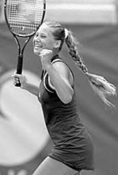 Anna Kournikova takes a break from calendar-modeling and exercise-video-shilling to play a little tennis.