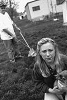 Yucko's head honcho Debbie Levy (foreground) with her dog Sasha and Harry the Executive Pooper-Scooper.
