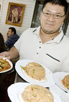 Simply Thai co-owner Scott Truong shows just a few of the 100 options on the menu.