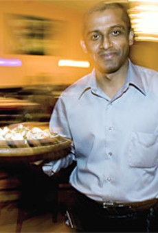 Akram Hoque, one of Saffron's three owners, serves traditional Indian fare.