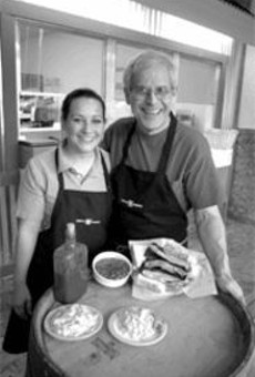 """""""I only serve what I like here"""": Plush Pig's Larry      Lampert (right, with daughter Angie)"""