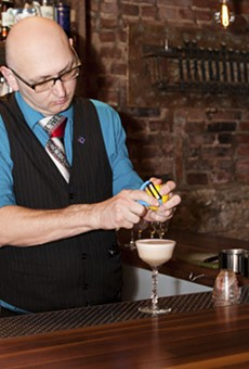 Taste mixologist Ted Kilgore concocting a Jazz Club cocktail from Jasmine Broker�s Gin, house-made grenadine, lemon and egg white. For a slideshow on Taste by Laura Ann Miller, go here.