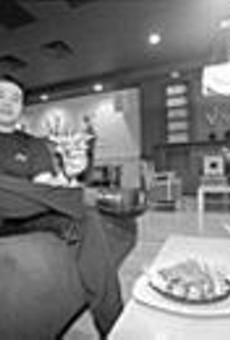 """Just loungin': Manager Thach """"Toc"""" Le of the Drunken Fish kicks back with a So roll"""