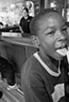 We all scream for ice cream: Ra'Heam Hudson      (background) waits for a cone as Ryan Moore      (foreground) enjoys his.