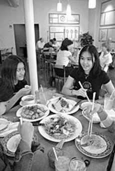 Crowd pleaser: Tammy Huynh (left) and Helen Pham      (right) enjoy Miss Saigon's flavorful fare.