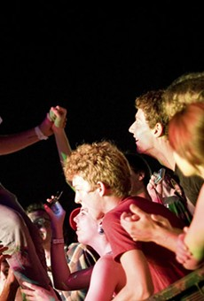 Kevin Drew of Broken Social Scene jumping into the crowd during last year's LouFest in Forest Park.