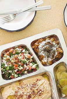 "Sameem's ""Mediterranean Feast"" includes falafel, eggplant-stuffed grape leaves, hummus and shirazi salad. Go here for more photos from Sameem Afghan Restaurant."