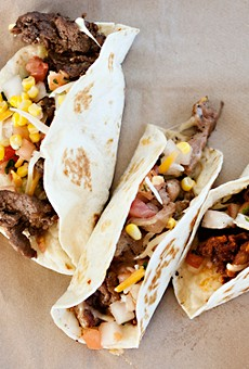 Rib-eye steak, chicken and spicy pork Korean barbecued tacos at Kim Cheese.See more photos from Kim Cheese here.