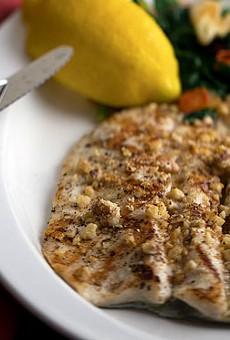 Walnut-encrusted trout with lemon butter and spinach. Slideshow: Inside Pan D' Olive on McCausland