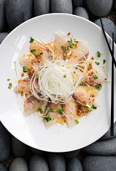 White fish carpaccio is dressed with olive oil, yuzu dressing, five-spice seasoning and garlic chips. Slideshow: Inside Takaya New Asian