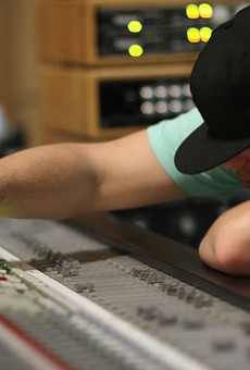 Derek Vincent Smith a.k.a Pretty Lights at the mixing board