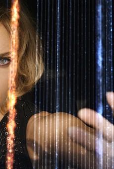 Scarlett Johansson Effortlessly Carries the Fun, Unscientific Lucy