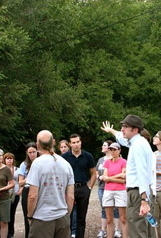 Michael Allen, in hat and bow tie, leads tours into the Pruitt-Igoe site.