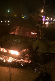 What's left of a police car after it was set on fire on South Florissant Road.