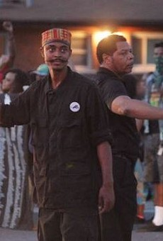 Olajuwon Davis, left, helped direct traffic during a celebratory protest in Ferguson in August.