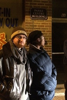 Greg Hilderbrand and Laura Charles guard their apartment Monday night in Ferguson.