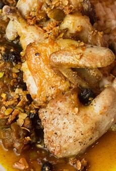 """Juniper's """"Country Captain"""": curry-glazed quail, Carolina-gold rice, currant stew and pistachio granola.   Photos by Mabel Suen"""