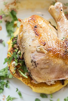 An arepa, a leavened corn pancake, topped with smoked Cornish hen. | Photos by Mabel Suen
