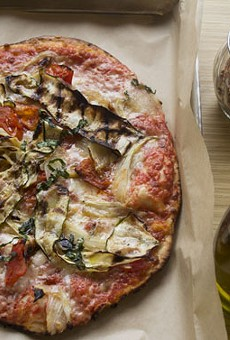 """Pizzino's """"Piero"""" grilled pizza with San Marzano tomatoes, fontina and pecorino blend, spicy roasted tomatoes, garlic, roasted zucchini, roasted fennel, basil and extra-virgin olive oil. 