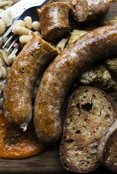 Hungarian bratwurst alongside roasted cauliflower, cider marrow beans, wheat toast and romesco sauce.