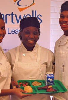 The winning team of student chefs in St. Louis' Healthy Schools Campaign Cooking up Change contest pose with their first-place meal.