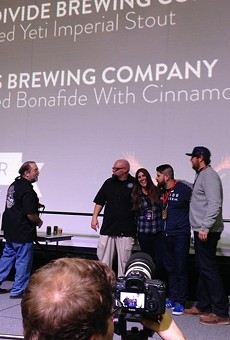4 Hands accepts medal for the Barrel Aged Bona Fide with Cinnamon.