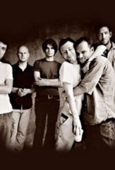 The dude about to get noogied by Thom Yorke is Nigel Godrich, the long-time producer of Radiohead. Godrich recently formed Ultraista, a side-band from his usual producing duties.