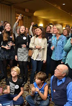 Supporters of Cort VanOstran watch election returns on Tuesday, November 6.