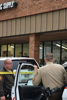 St. Louis County police still had the Catholic Supply store taped off this morning.