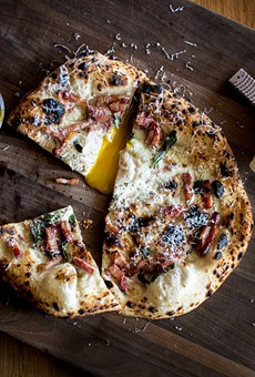 Pizza at The Good Pie featuring egg, cured pork belly, parmigiano and sage.