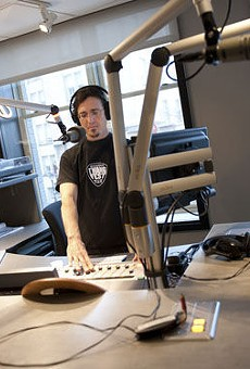 KDHX's Andy Coco broadcasting from the studios of the station's newly opened Larry J. Weir Center for Independent Media.