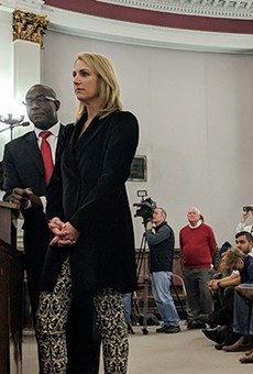 Aldermanic President Lewis Reed and Carolyn Kindle Betz, a  member of the proposed ownership group.