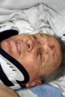 Ed Domain in the hospital after his accident in an uninsured cab