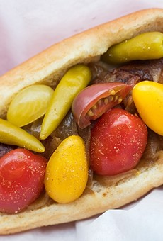"""The """"St. Louis"""" dog features Provel, bacon, caramelized onion, tomato, sport peppers and celery salt."""