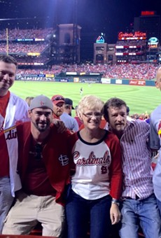 Chris Sanna's mom shared this photo of her family enjoying the Cardinals game — just before Chris, center right, was shot.