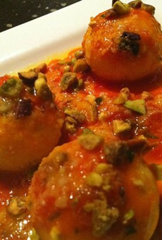 Ricotta gnudi with tomato sauce and pistachios