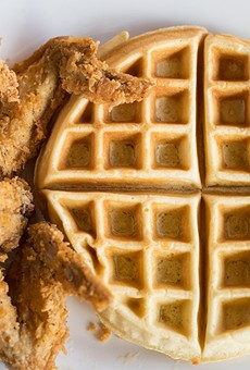 An offering of chicken and waffles pairs three chicken wings with a Belgian waffle.