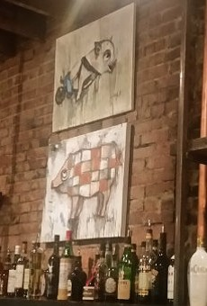 The bar at The Copper Pig has a stylish feel — and some good pig art.