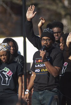 """""""How Mizzou responds to the threat on Black lives today will dictate the progress of the school for the next 10+ years,"""" grad student Jonathan Butler, center, tweeted on November 11."""