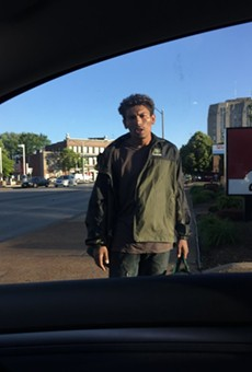 This man, shown in May, told motorists in a Taco Bell drive-thru he could fix dents in their cars, a witness says.