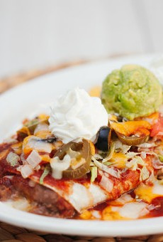 "Hacienda's signature ""wet burrito"" comes smothered in cheesy sauce."