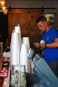A bartender at Tropical Liqueurs' opening weekend in Soulard.