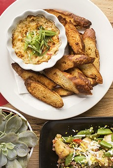 A selection of dishes from Olive + Oak: grilled asparagus, blue-crab gratin, tagliatelle and niçoise potatoes.