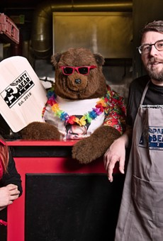 Melanie Meyer, left, and Chris Ward with their new eatery's eponymous mascot.