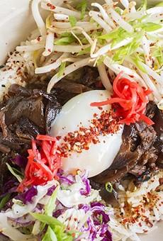 Gyudon with soy-dashi braised Missouri beef, slow-cooked egg, seasoned rice, cabbage and togarashi.