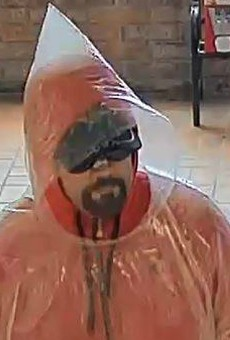 A poncho-wearing robber on Sunday holds up a Collinsville bank.