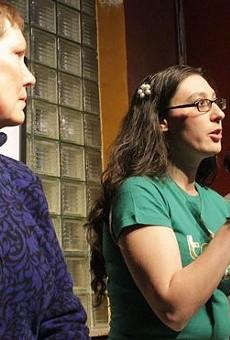 Alderwoman Megan Ellyia Green, center.