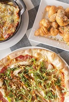 Dishes include lasagna, garlic knots and pizza.